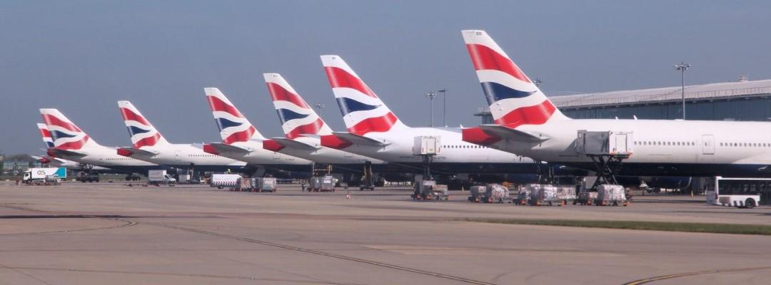 Row of British Airways Boeing 777s at London Heathrow airport.