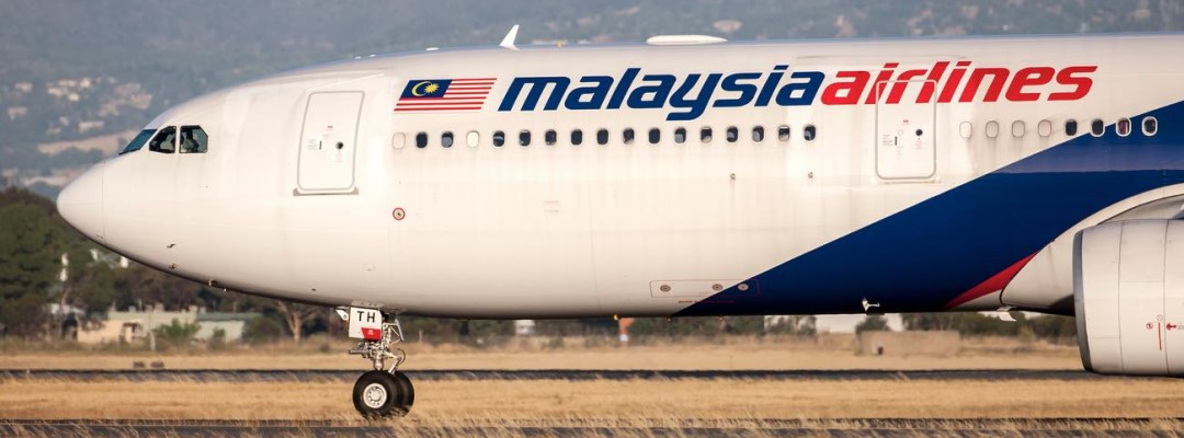 Malaysia Airlines Airbus A330 aircraft registration 9M-MTH taxis from the runways