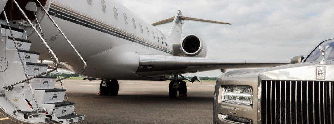 Private executive airplane with Rolls Royce Phantom luxury car shown together.
