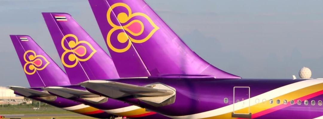 Tail of 3 Thai Airways plane parking at domestic gate prepare next flight