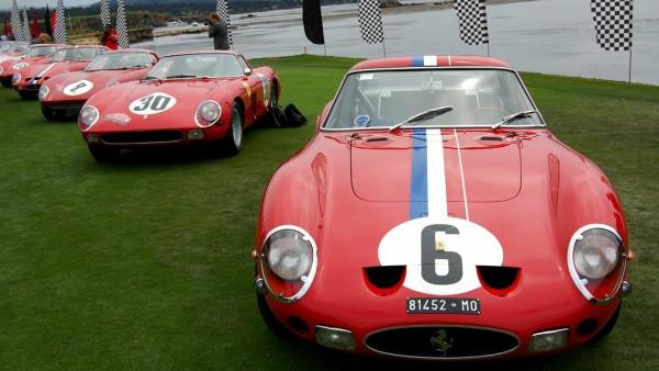 A line of Ferrari GTOs at a vintage car-show