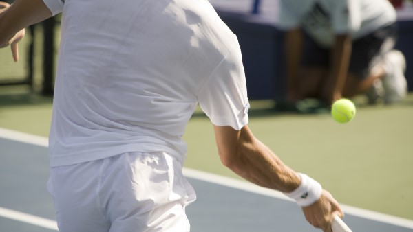 Tennis player in action about to hit the ball