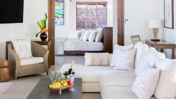 Beachfront villa seating area, leading through to the bedroom