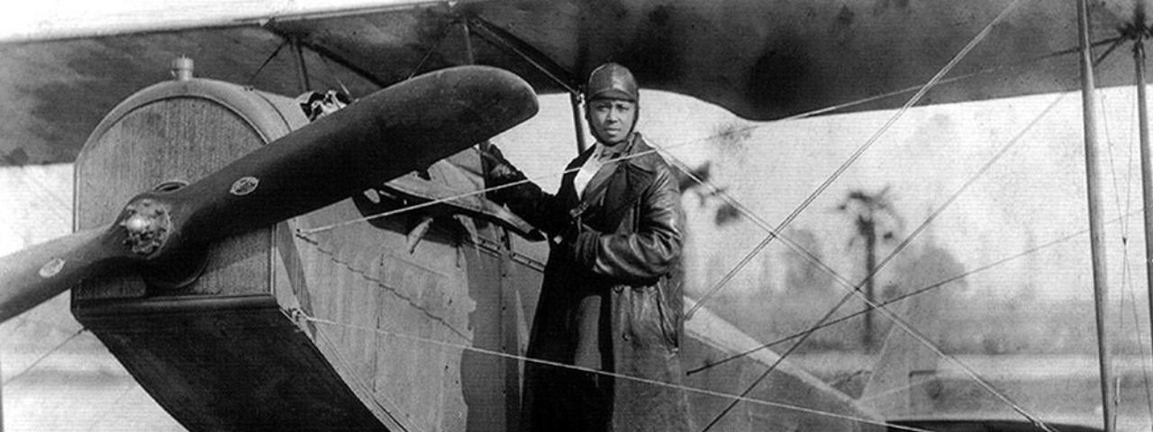 Bessie Coleman with her plane in 1922