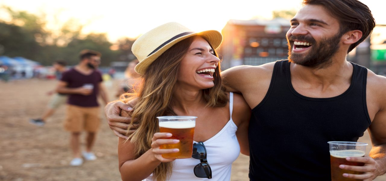Young and cheerful couple at a beer festival.