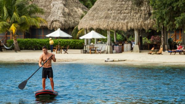 Paddle boarding at Coral Caye