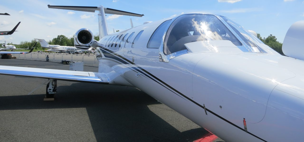 Close up of the exterior of a Cessna Citation CJ3+ parked at an airport
