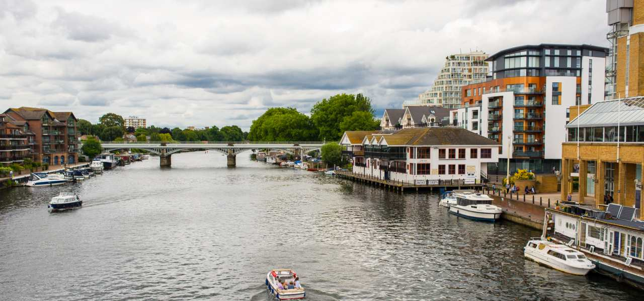 View of boats on the thames and flats in Kingston Upon Thames.