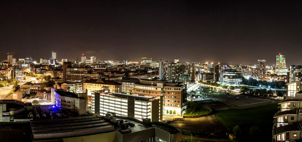 Panoramic view of the city of Leeds at night.