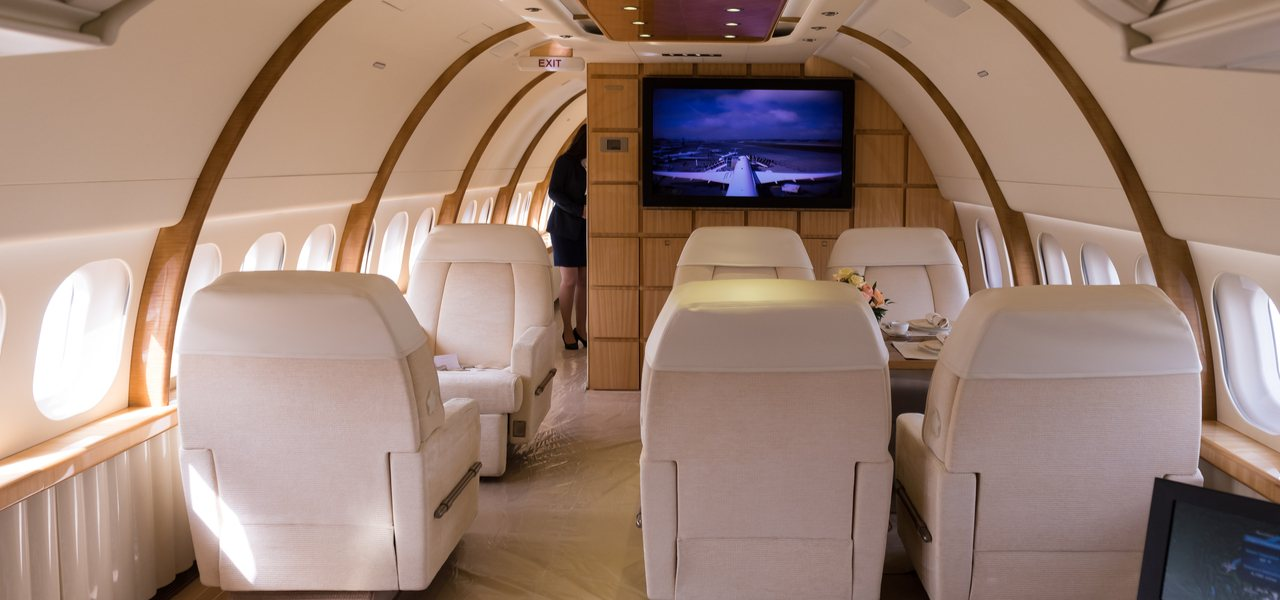 interior view of private jet with white leather seats