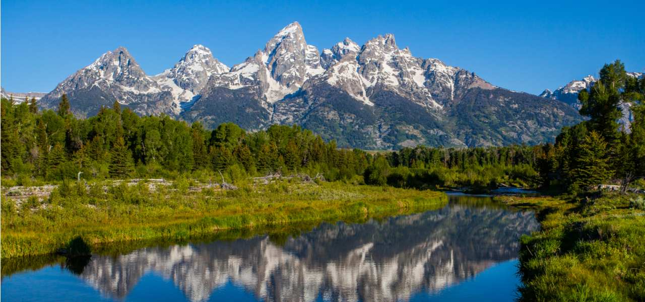 Grand Teton National Park in Wyoming on a clear blue sky day.