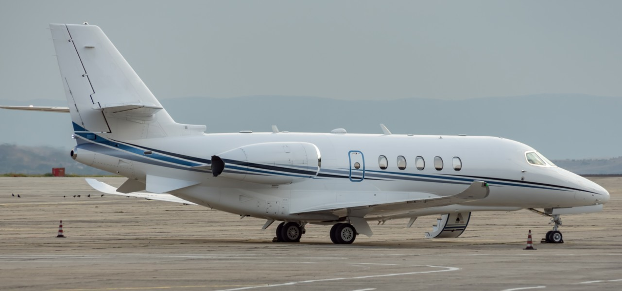 Cessna Citation X private jet parked on runway