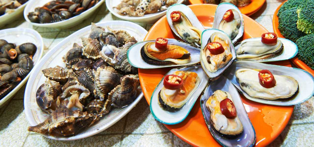 Close up of dishes of Chinese seafood