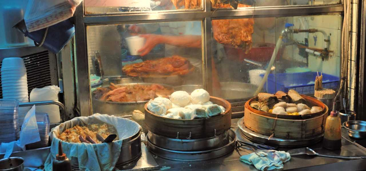 Kitchen view of traditional Chinese food being prepared