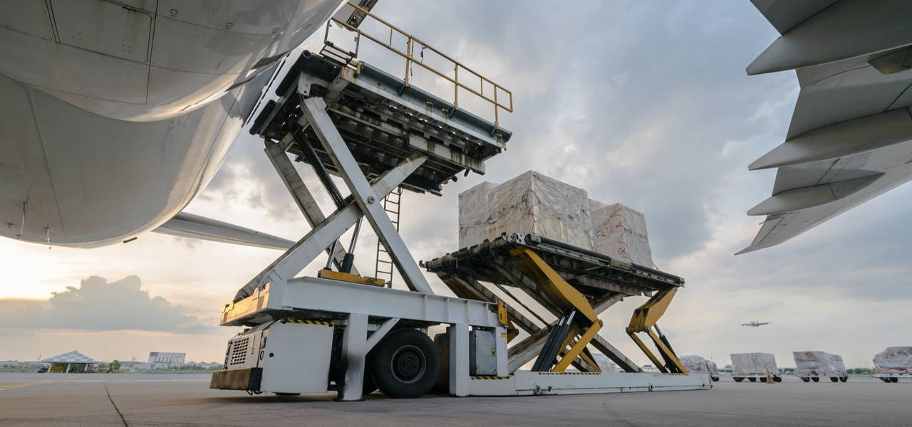 Ground shot perspective of cargo being loaded onto an air cargo plane