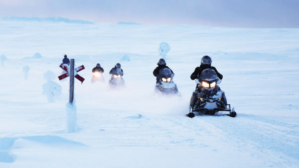 Snowmobiling to the Northern Lights