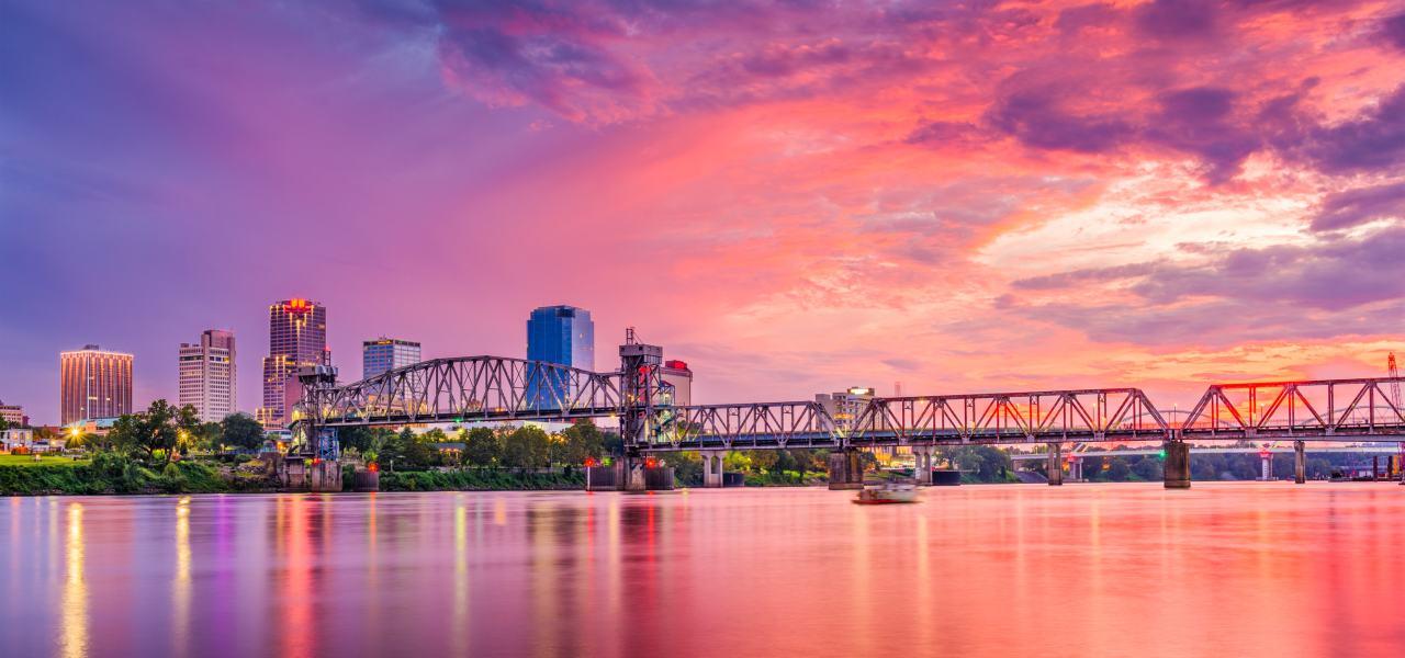 Little Rock Arkansas downtown skyline during a pink sunset on the Arkansas River