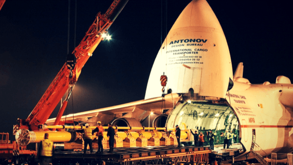 Stationary Antonov aircraft with heavy cargo being loaded into the jet