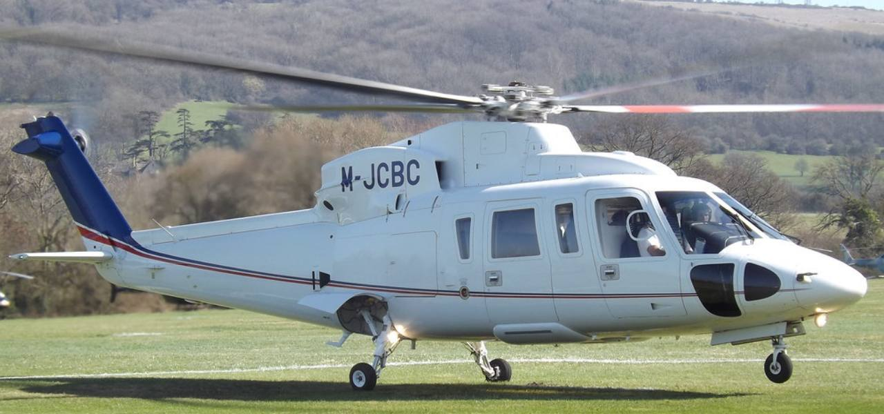 Closeup of white Sikorsky S-76 helicopter about to take off