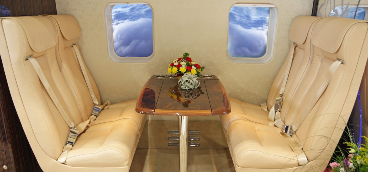 Cream leather interior of luxury salon inside private helicopter