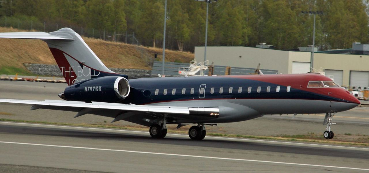 The Bold Look branded private jet landing at airport