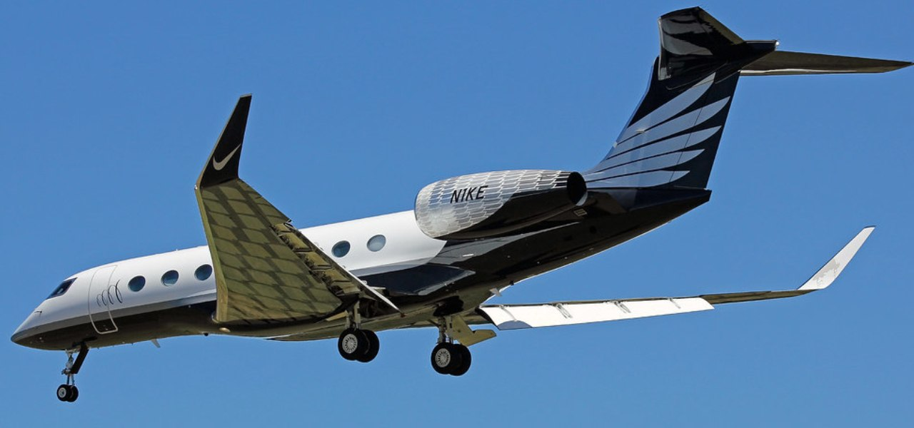 Nike feather branded Gulfstream G650 private jet in flight