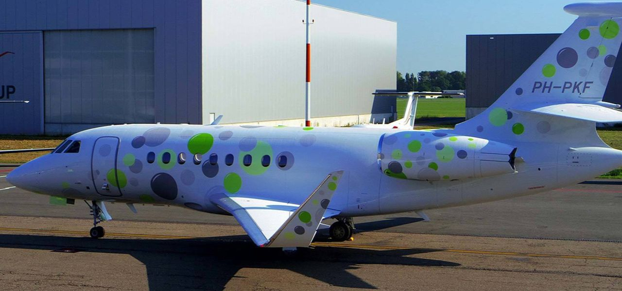 Peter Kutemann private jet branded with colorful bubbles