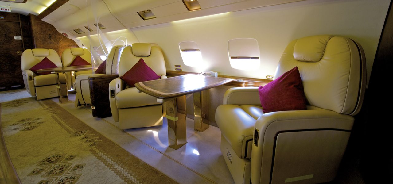 Beautiful interior of private business jet with cream leather seats