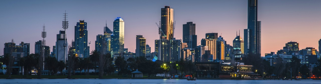 Melbourne's city skyline at dawn by Albert Park Lake