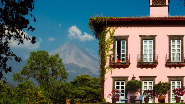 House and gardens at the Hacienda with view of volcano.