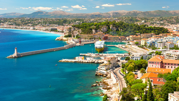 Summer vacation view of harbour in Nice in the French Riviera overlooking the sea and mountains