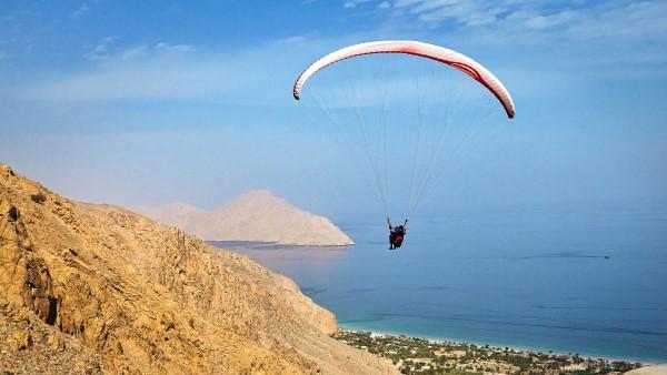 Paragliding over Zighy Bay, Oman