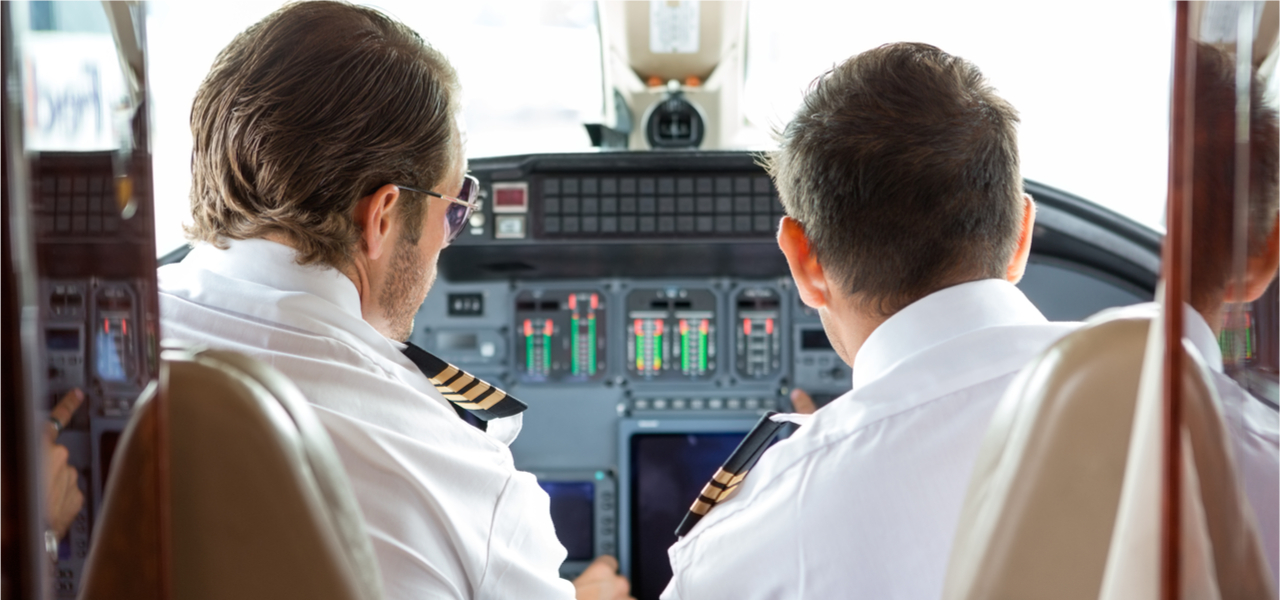 Two pilots in aircraft cockpit