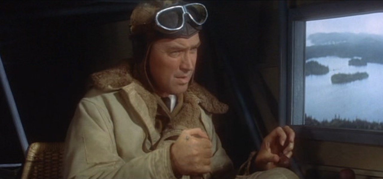 Movie Clip from The Spirit of St. Louis, of pilot with flight goggles on his head holding pilot controls