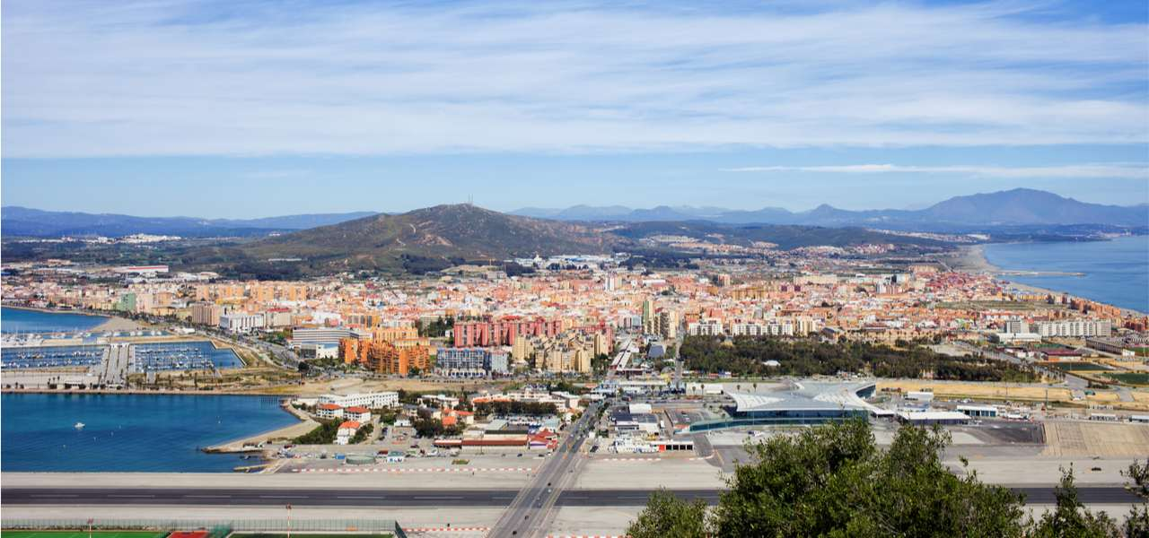 Gibraltar airport runway with the town of La Linea de la Concepcion in the background, Spain