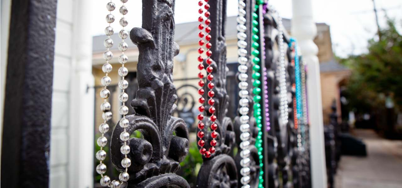 Beaded necklaces hanging on railings as part of Mardi Gras