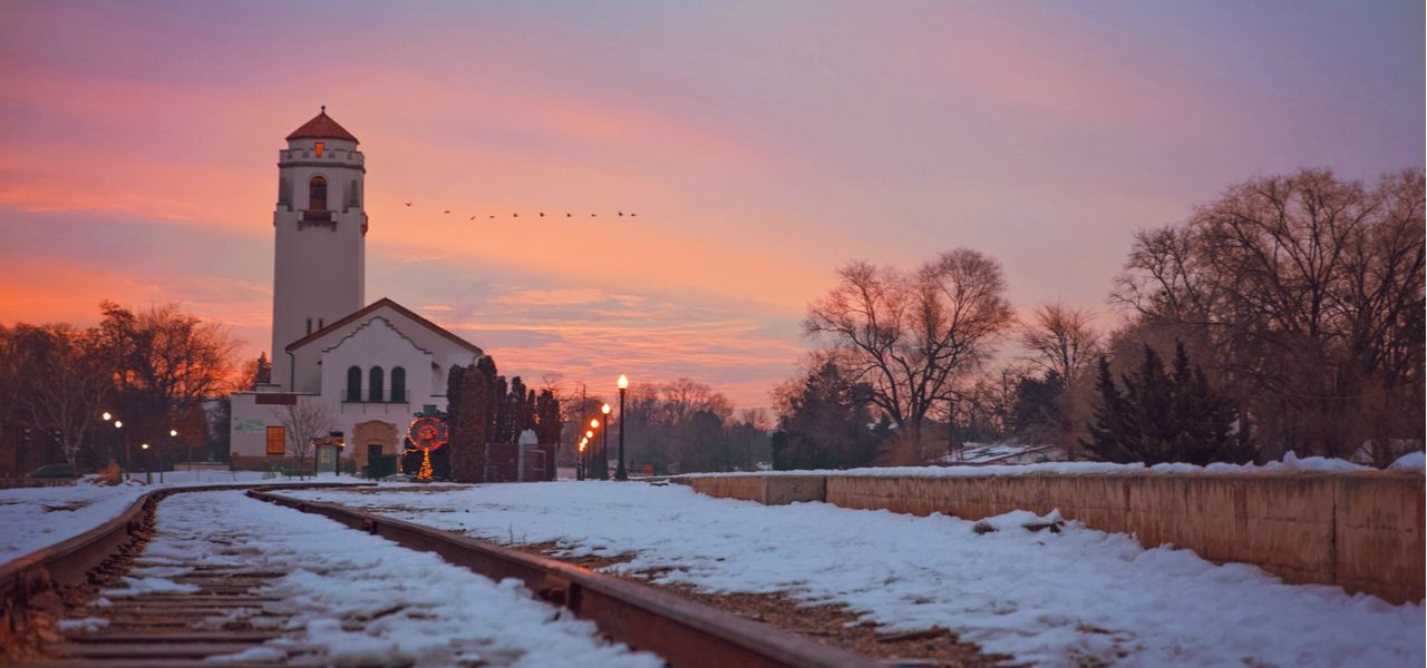 A view from the Boise train depot at dawn, with snow covering the train tracks