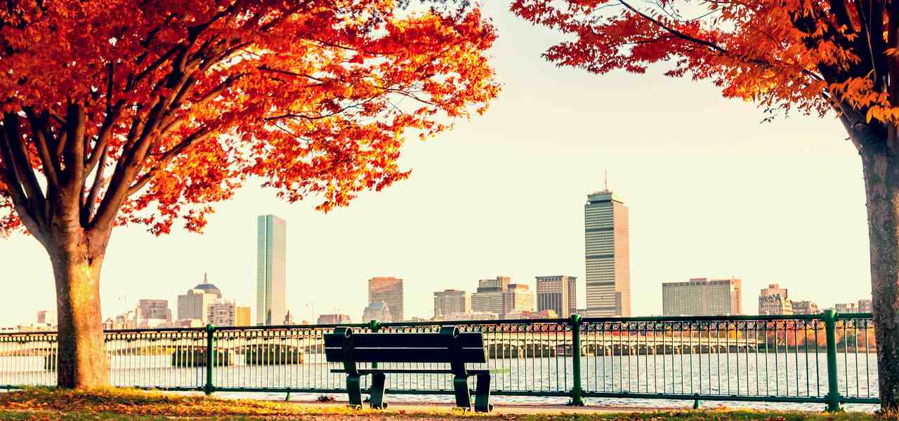 A view of the Boston Skyline in autumn from across the river