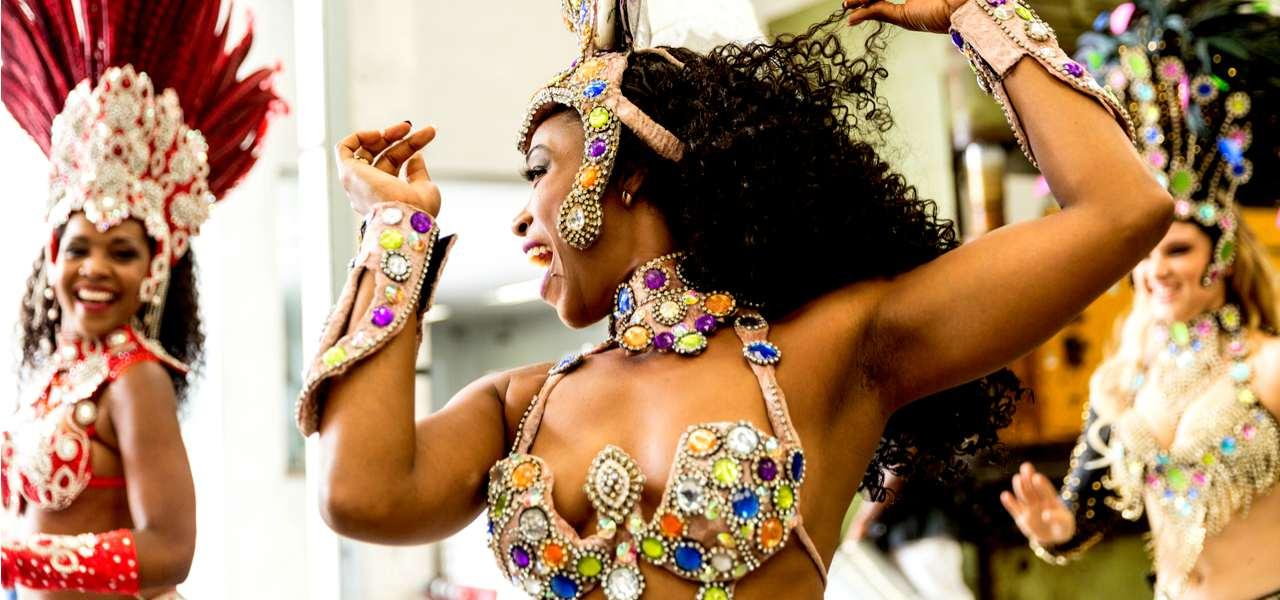 Brazilian woman dancing samba music at carnival party