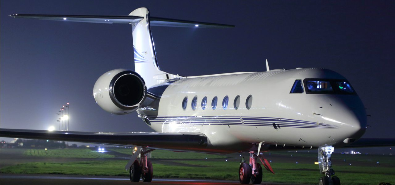 A business Jet Parked on a runway ready to take off