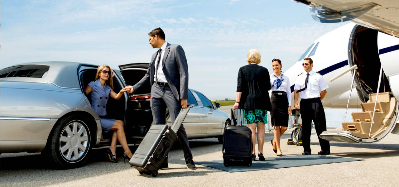 Business people boarding a private jet
