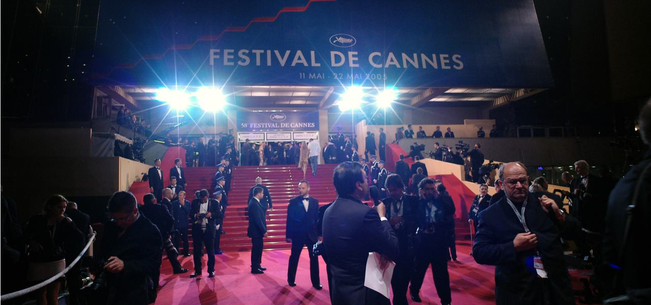 Cannes Film Festival guests await the action on the red carpet
