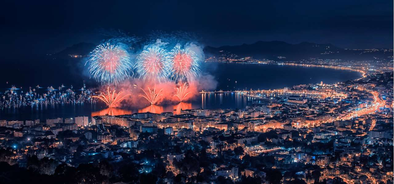 Fireworks erupt over the skyline of Cannes, France, for New Year