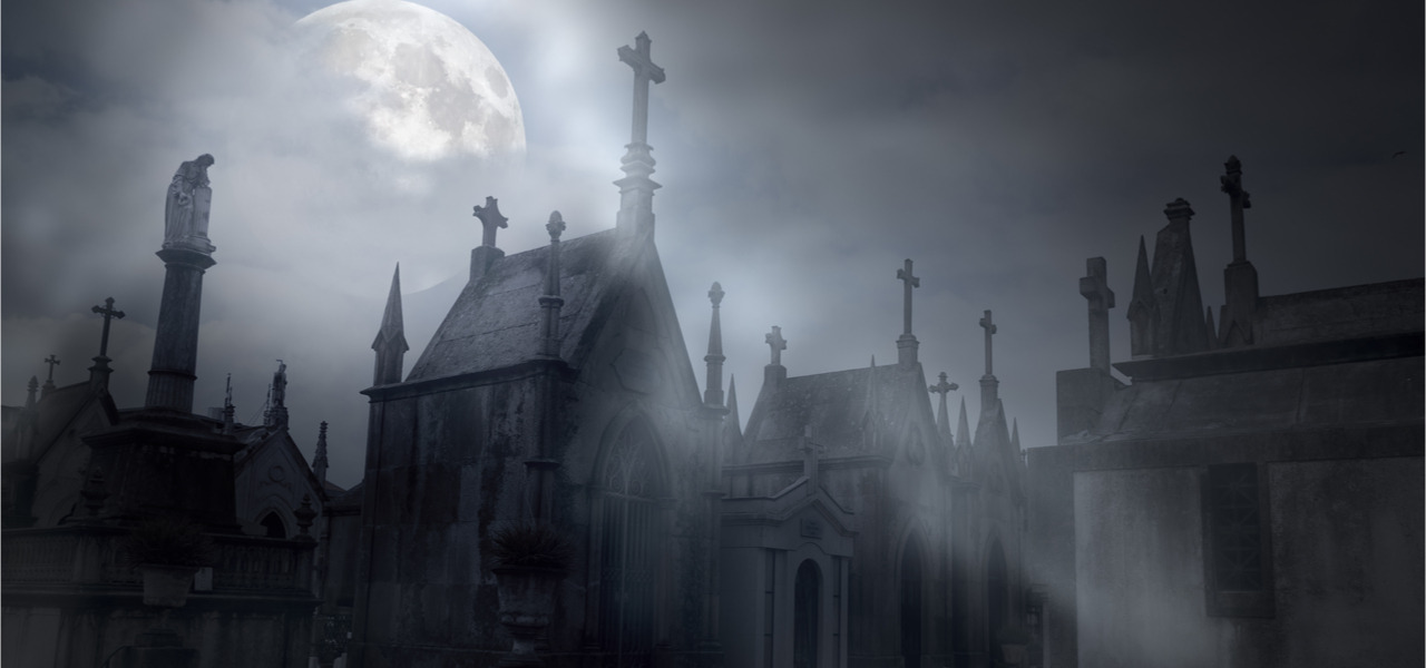 Old cemetery in a foggy full moon night