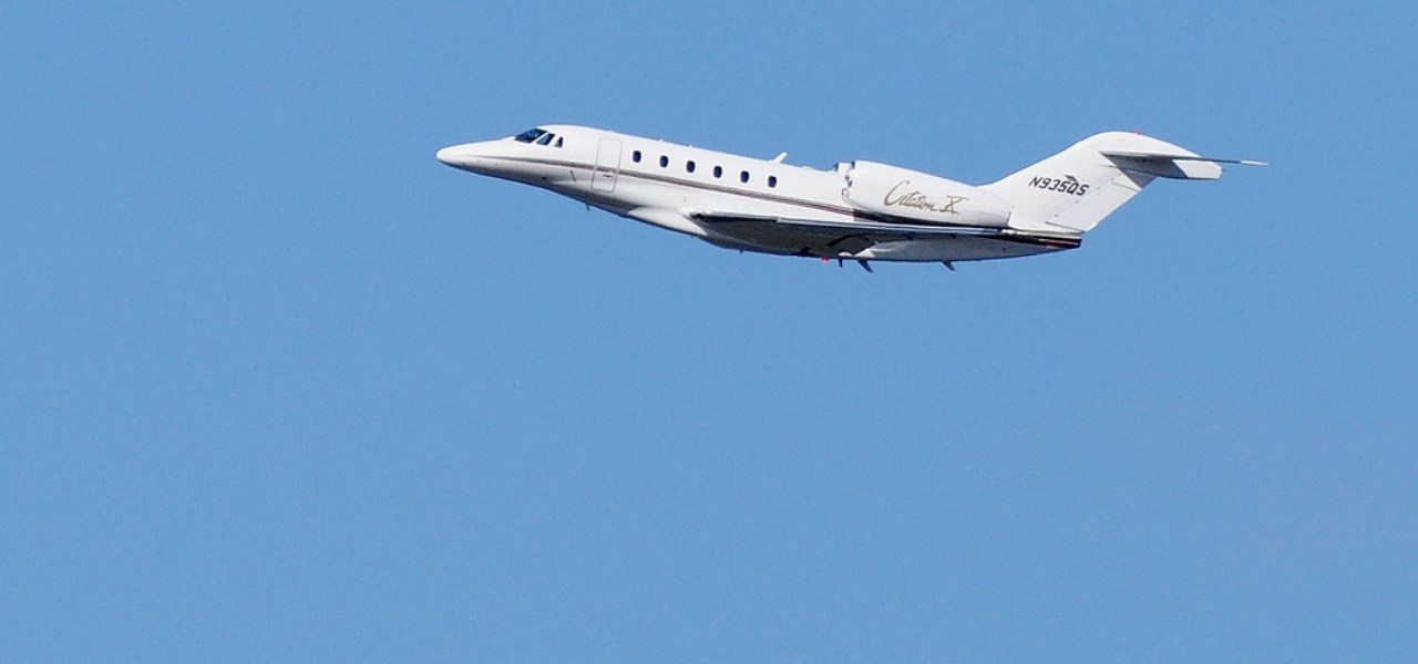 The Cessna Citation X in a blue cloudless sky.