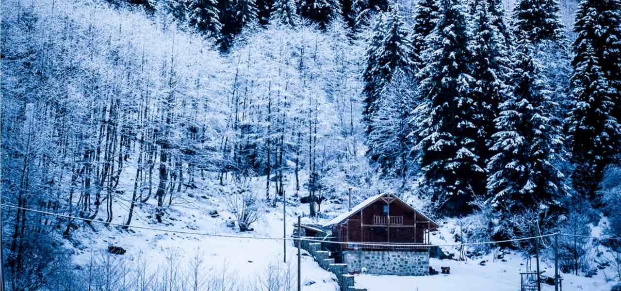 Beautiful view of traditional rustic wooden mountain chalet secluded in Courchevel.