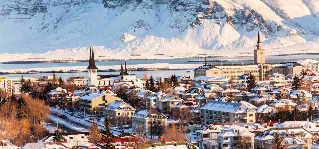 A view of Reykjavik, capital of Iceland, with mountains in the distance
