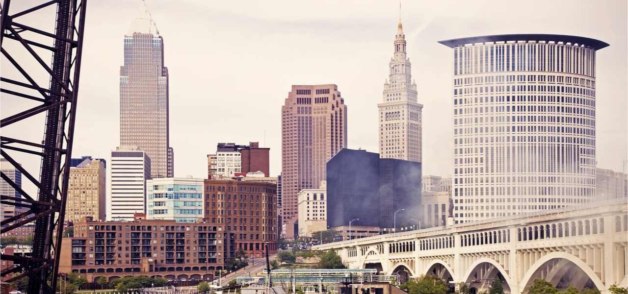 Skyline of Cleveland and a large passenger/tourist boat on Cuyahoga River