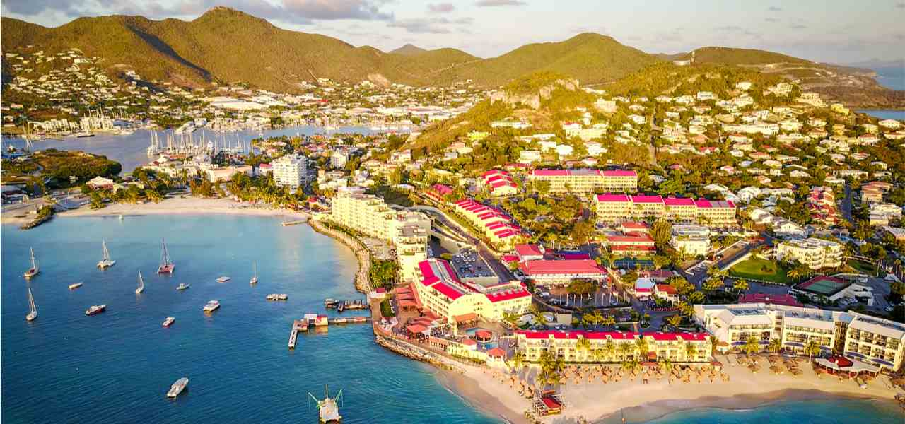 Drone view of tropical resorts built on the coastline in Saint Martin