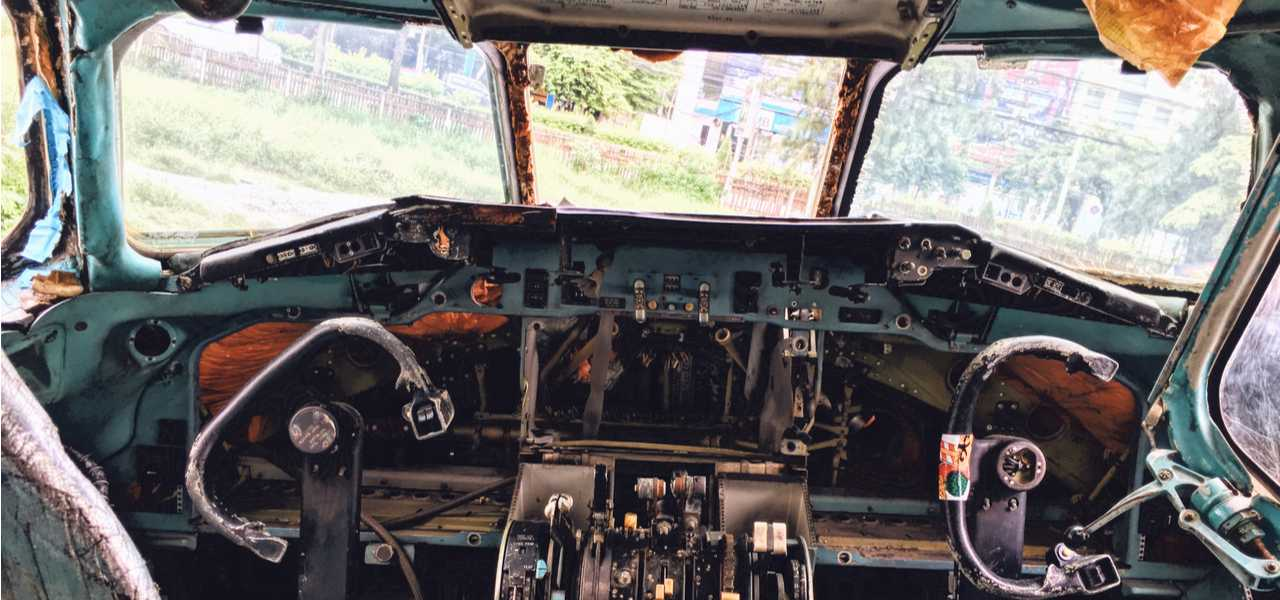 A look inside the cockpit of a derelict airplane at an airplane graveyard